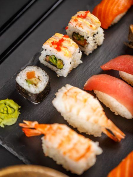 Sashimi sushi set and sushi rolls with soy and ginger