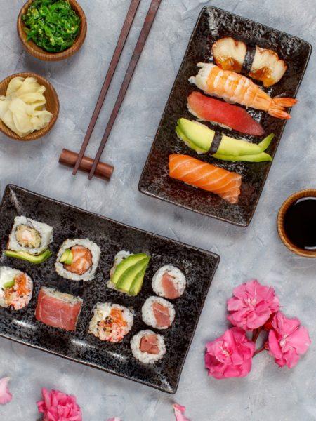 Sushi Set nigiri and sushi rolls on rectangular plates top view